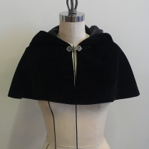 Made of black cotton velveteen with faux silk lining, closes with metal clasp at neck. One size fits most. Available September 2013.